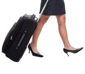 businesswomans-legs-with-suitcase